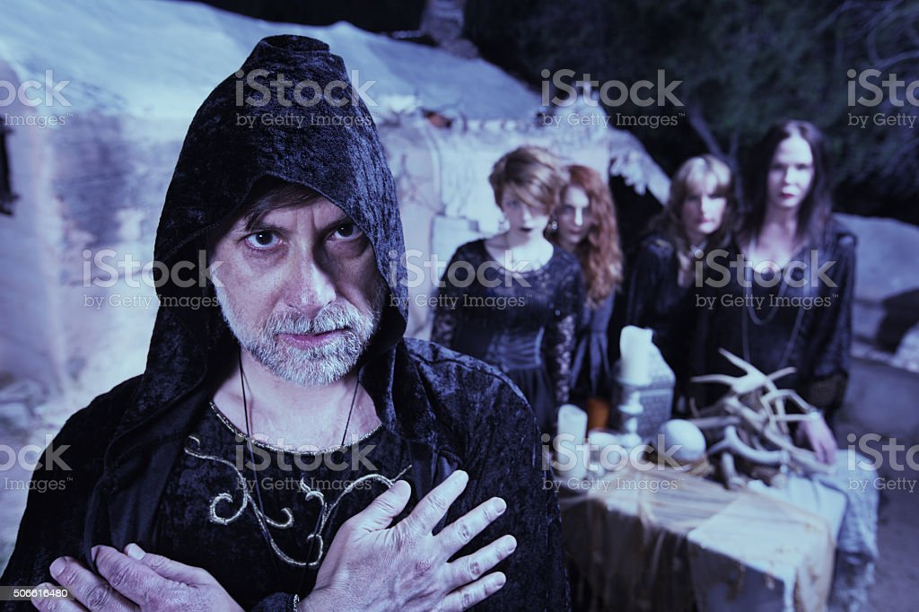 Occult Man with Women stock photo