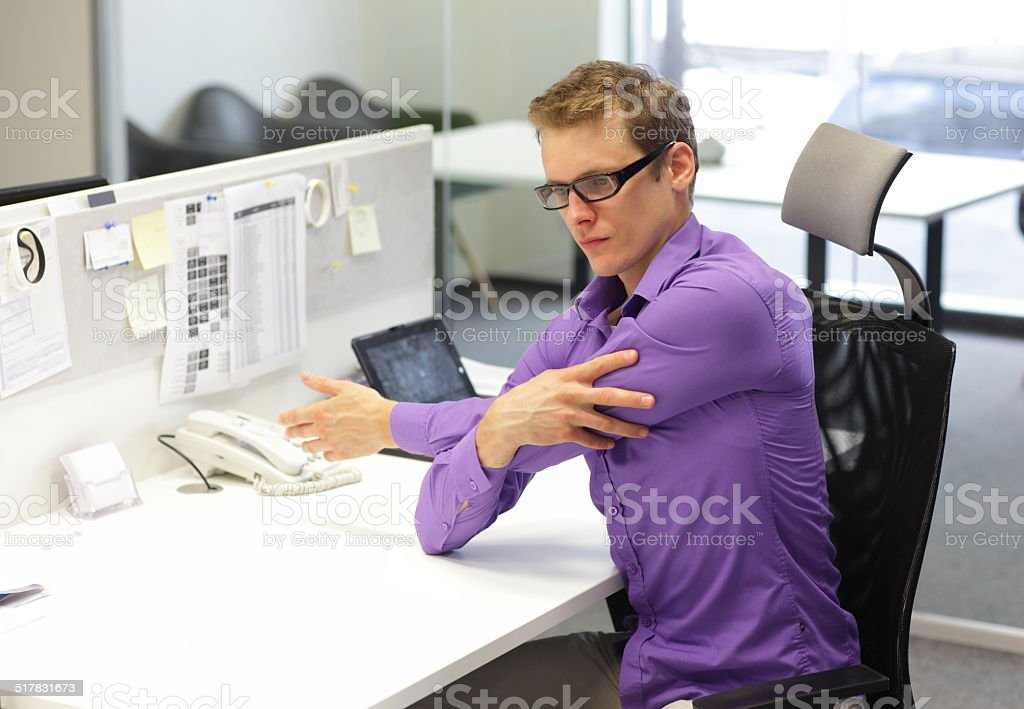 occupational disease prevention - exercise in office stock photo
