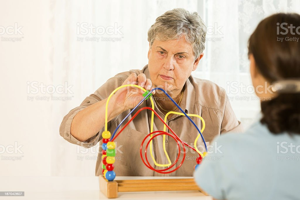 Occupational Therapy: Senior woman with motor activity loop stock photo