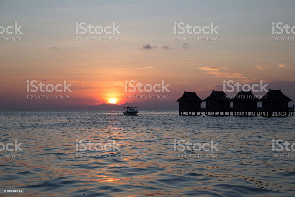 Ocean and bungalow. stock photo
