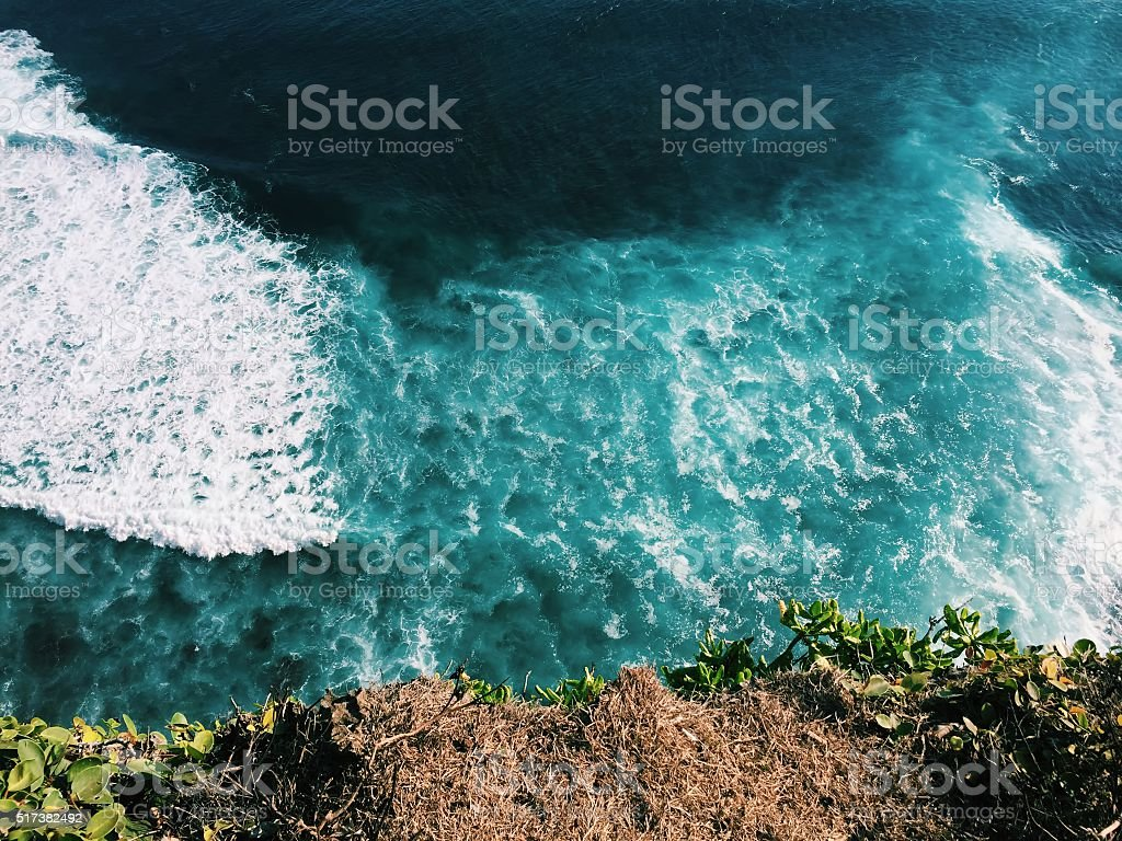 Ocean and rip curl view from abrupt cliff coast stock photo