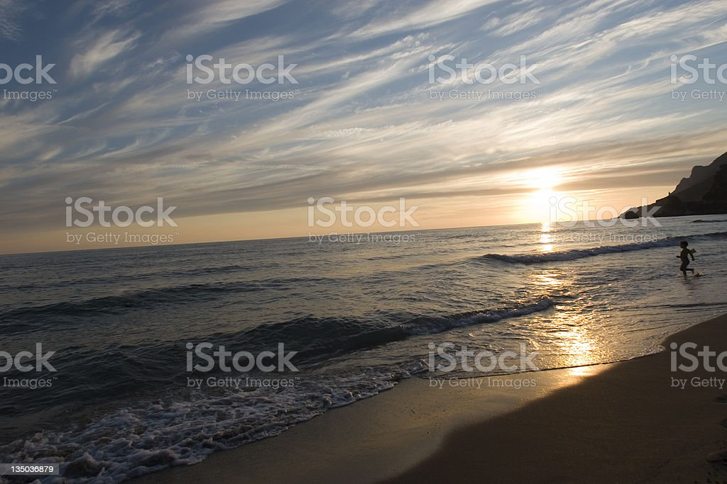 Ocean and sunset on the beach at night royalty-free stock photo