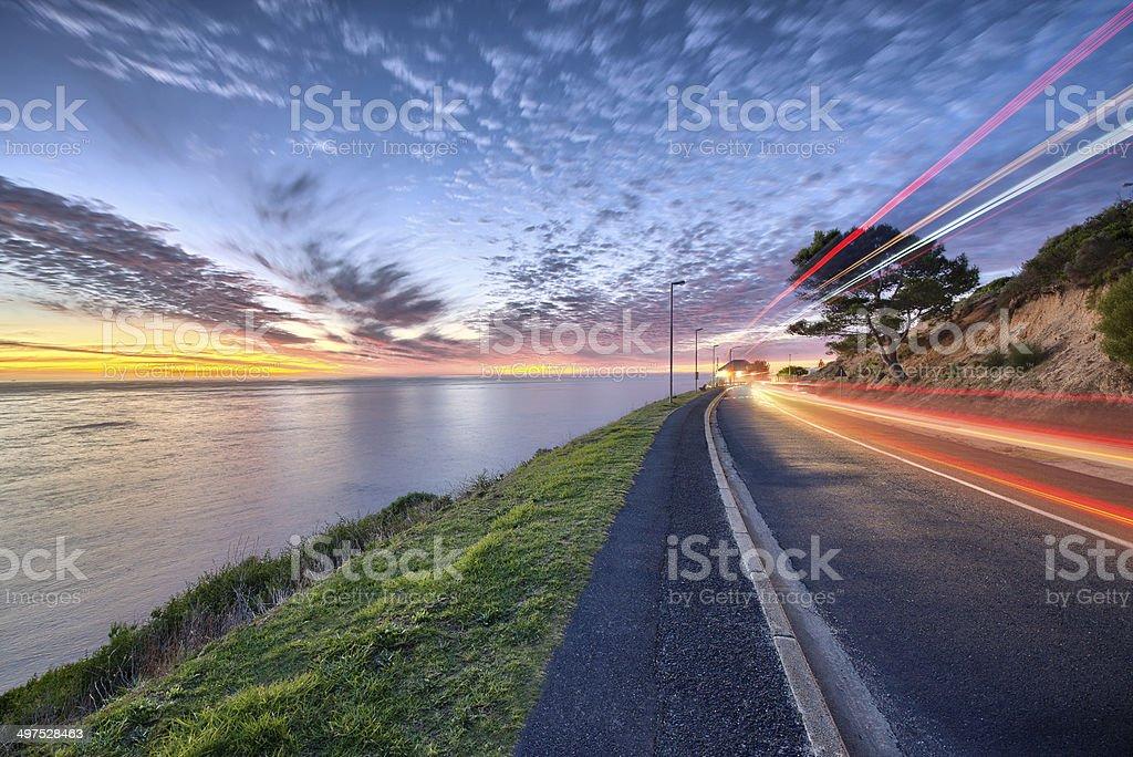 Ocean and urban sunset stock photo