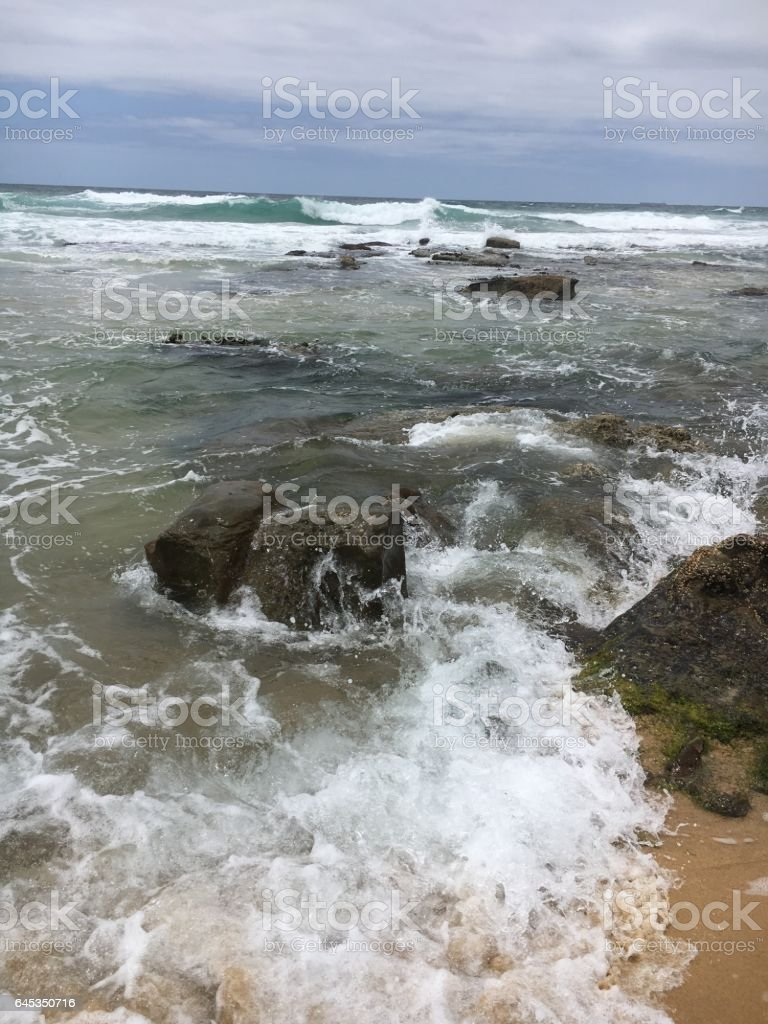 Ocean around Rocks stock photo