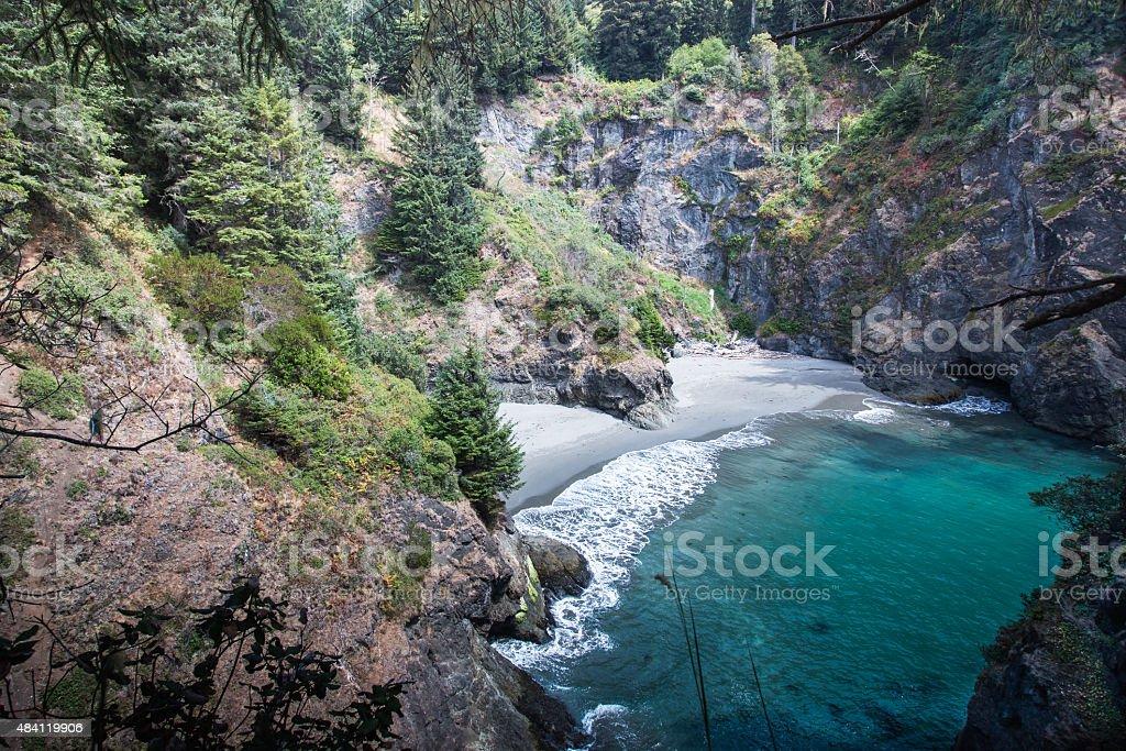 Ocean beach and rocks top view stock photo