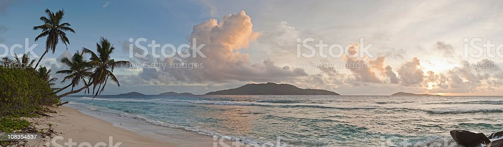Ocean beach palm tree sunrise panorama tropical island shore Seychelles royalty-free stock photo