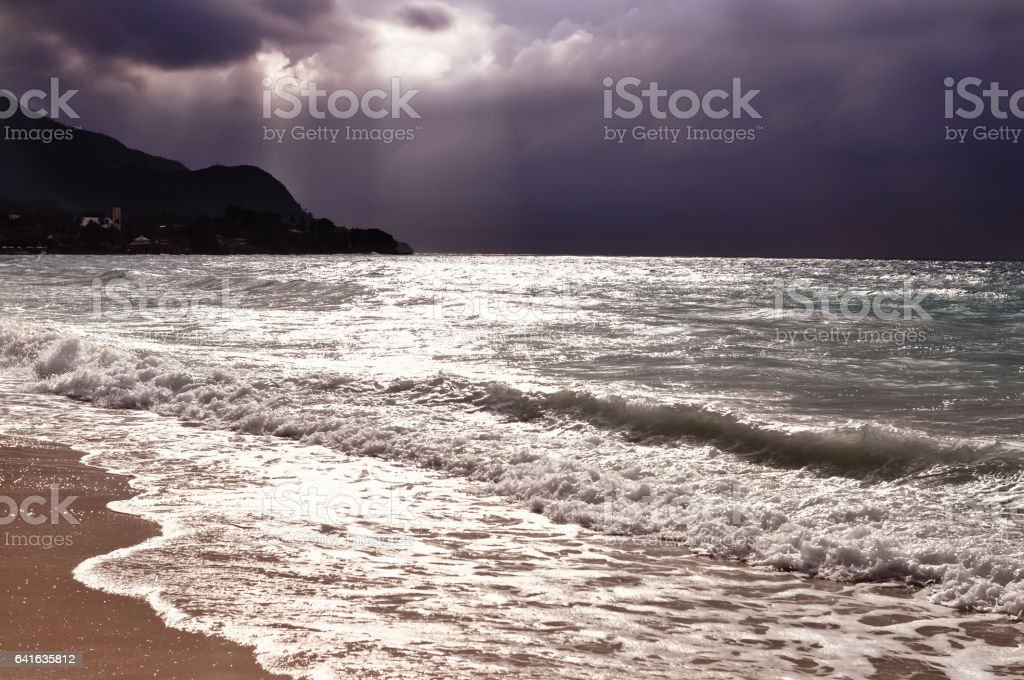 Ocean before storm with beautiful purple sky expressive seascape stock photo