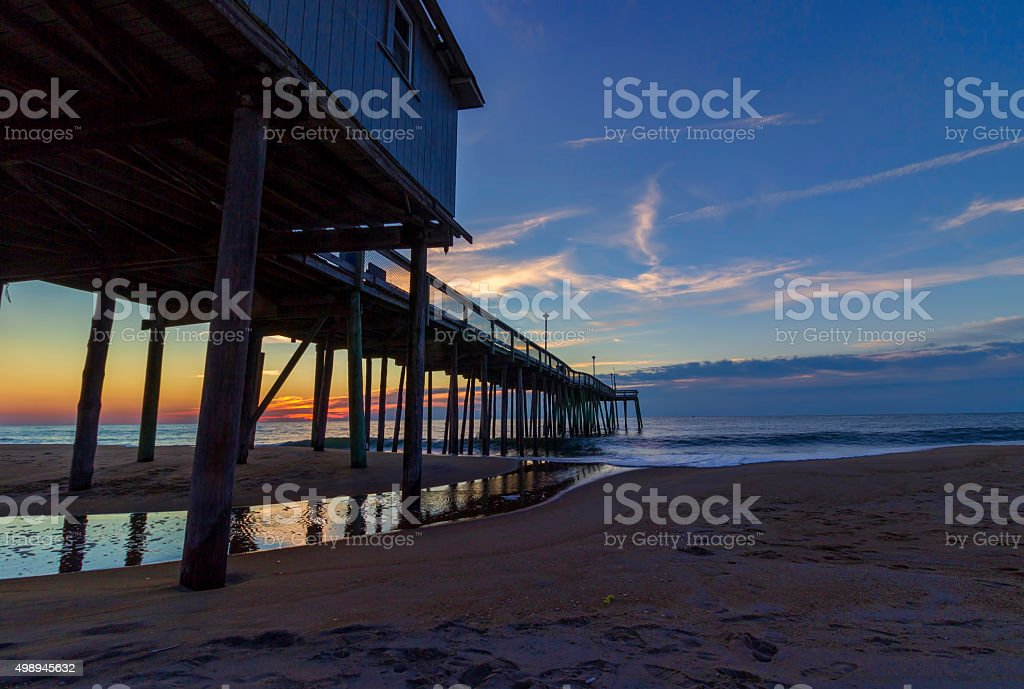 Ocean City, MD fishing pier and ocean at sunrise stock photo