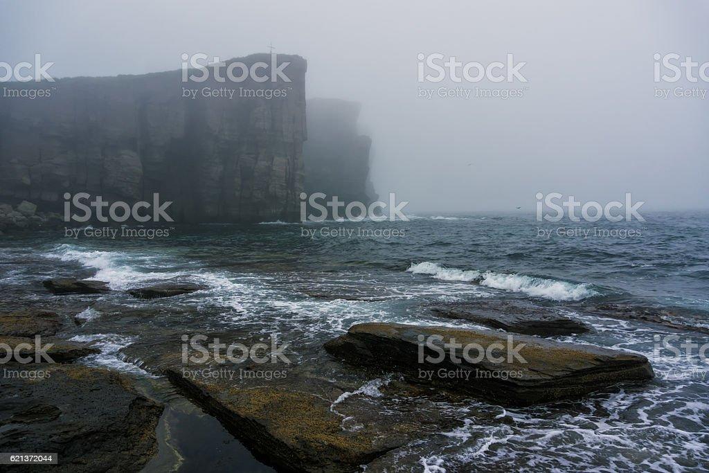 Ocean cliffs in heavy fog stock photo