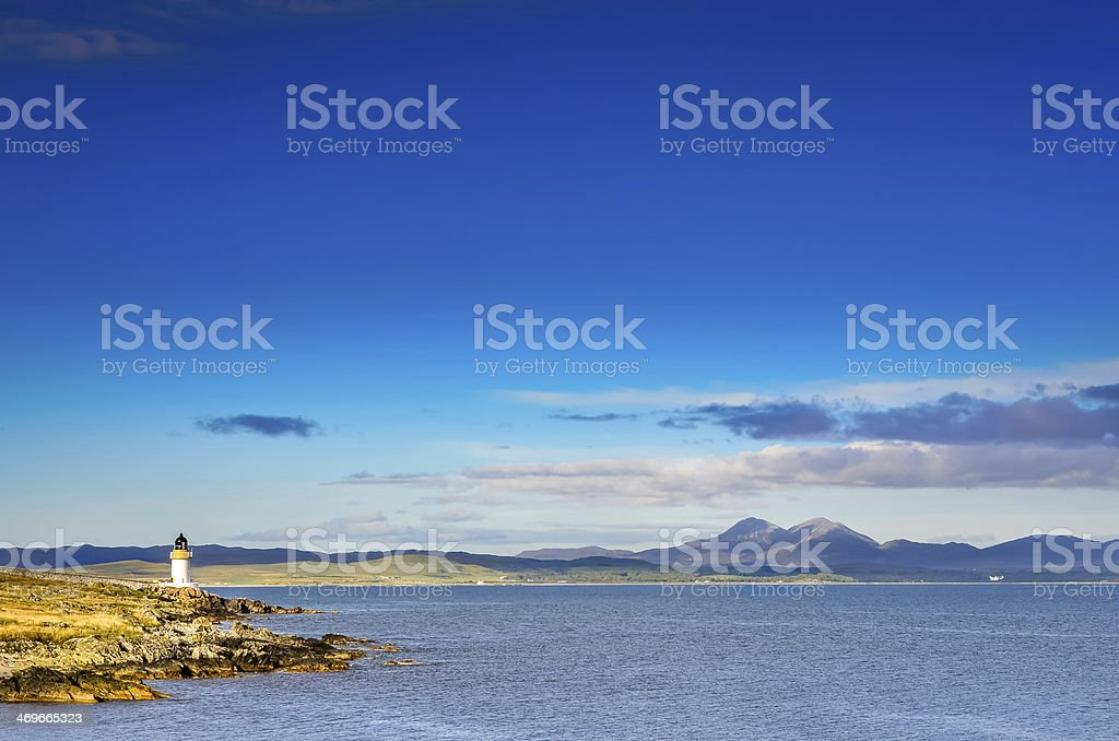 Ocean coast lighthouse in Port Charlotte, Scotland stock photo