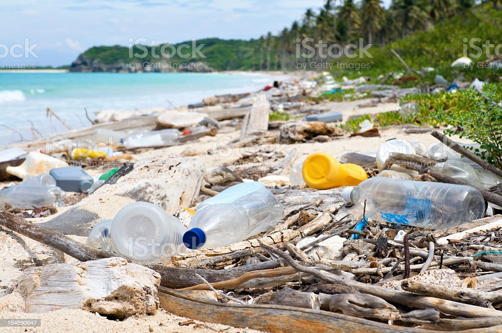 Ocean Dumping - Total pollution on a Tropical beach stock photo