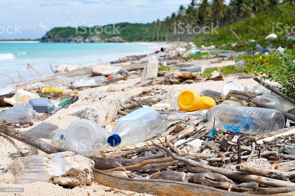 Ocean Dumping - Total pollution on a Tropical beach stock photo