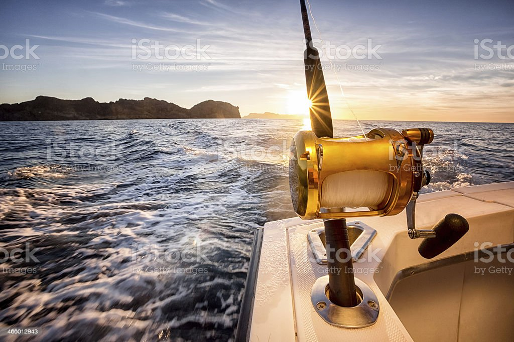 Ocean Fishing Reel on a Boat in the Ocean stock photo