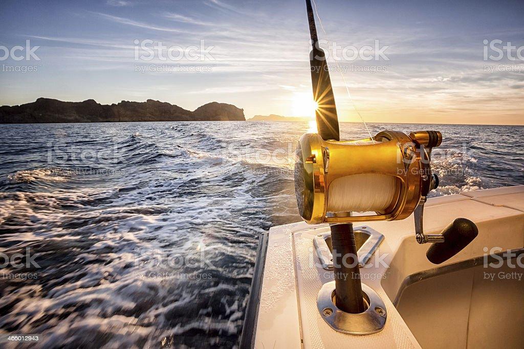 Ocean Fishing Reel on a Boat in the Ocean stock photo