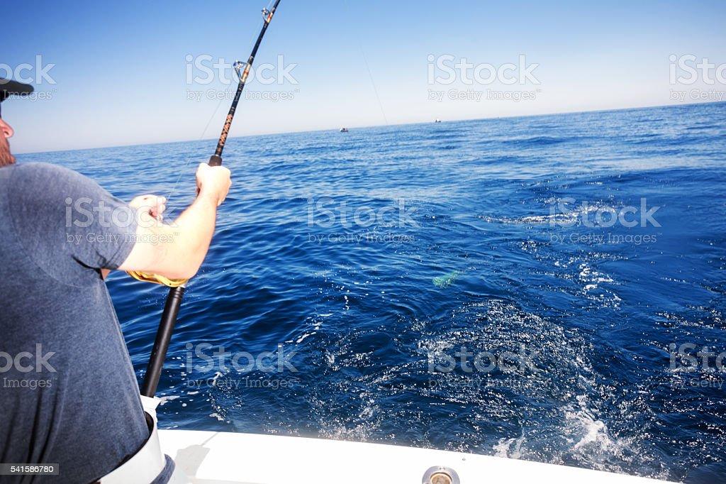 Ocean Fishing Reels on a Boat in the Ocean stock photo