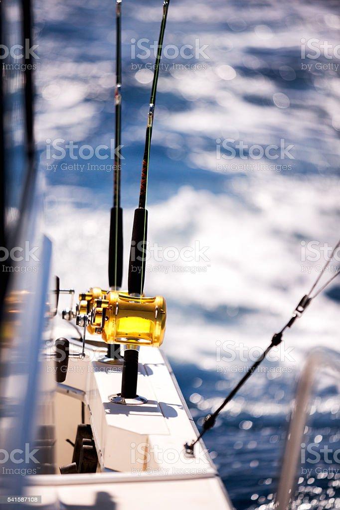 Ocean Fishing Reels on a Boat in the Ocean stock photo