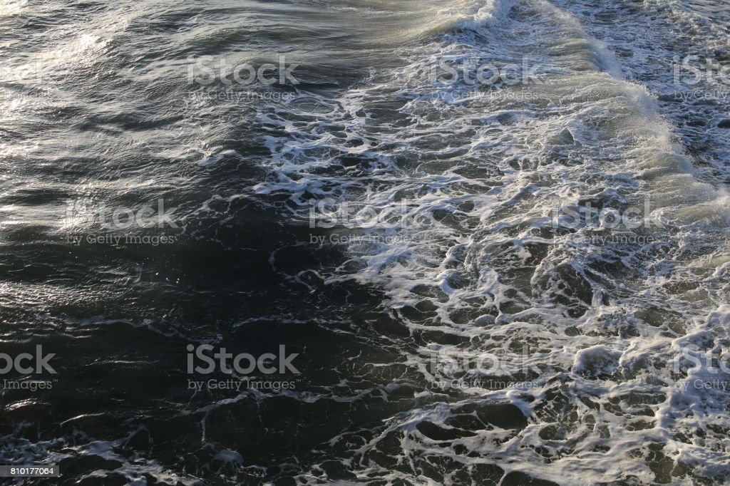 Ocean foam. Close up stock photo