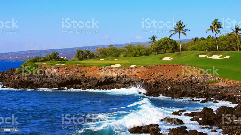 Ocean front Golf course green and hole on Maui Hawaii stock photo