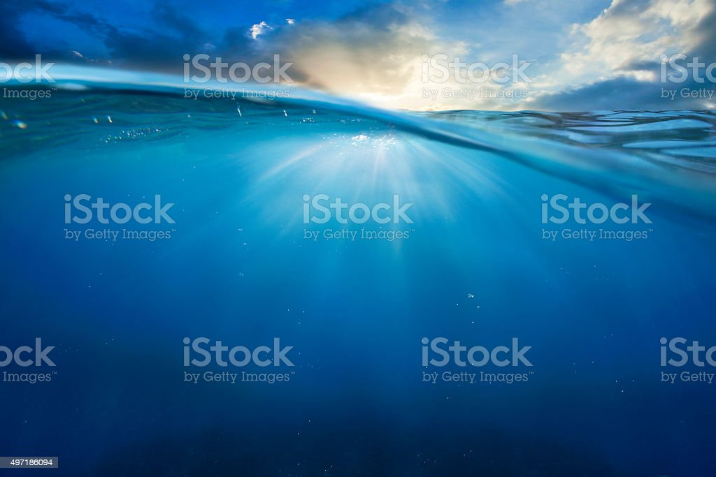 ocean half water with sunset sky stock photo