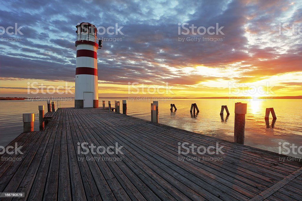 Ocean Lighthouse at sunset stock photo