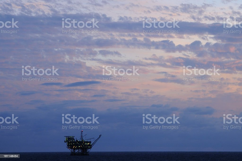 Ocean oil rig at twilight royalty-free stock photo