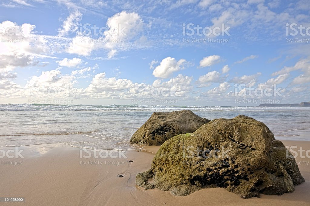 Ocean, rocks and clouds stock photo