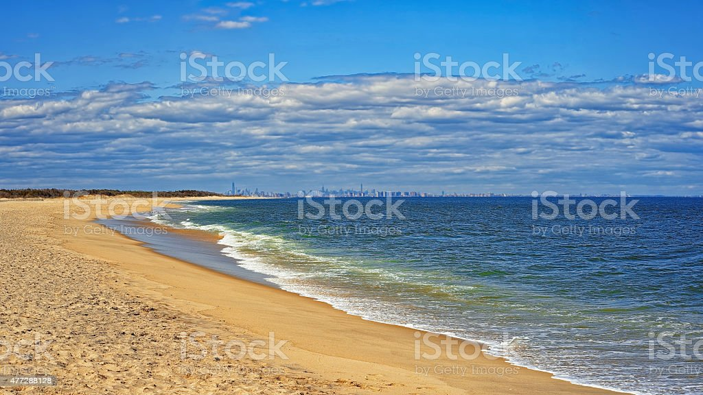 Ocean shore and view to NYC from Sandy Hook stock photo