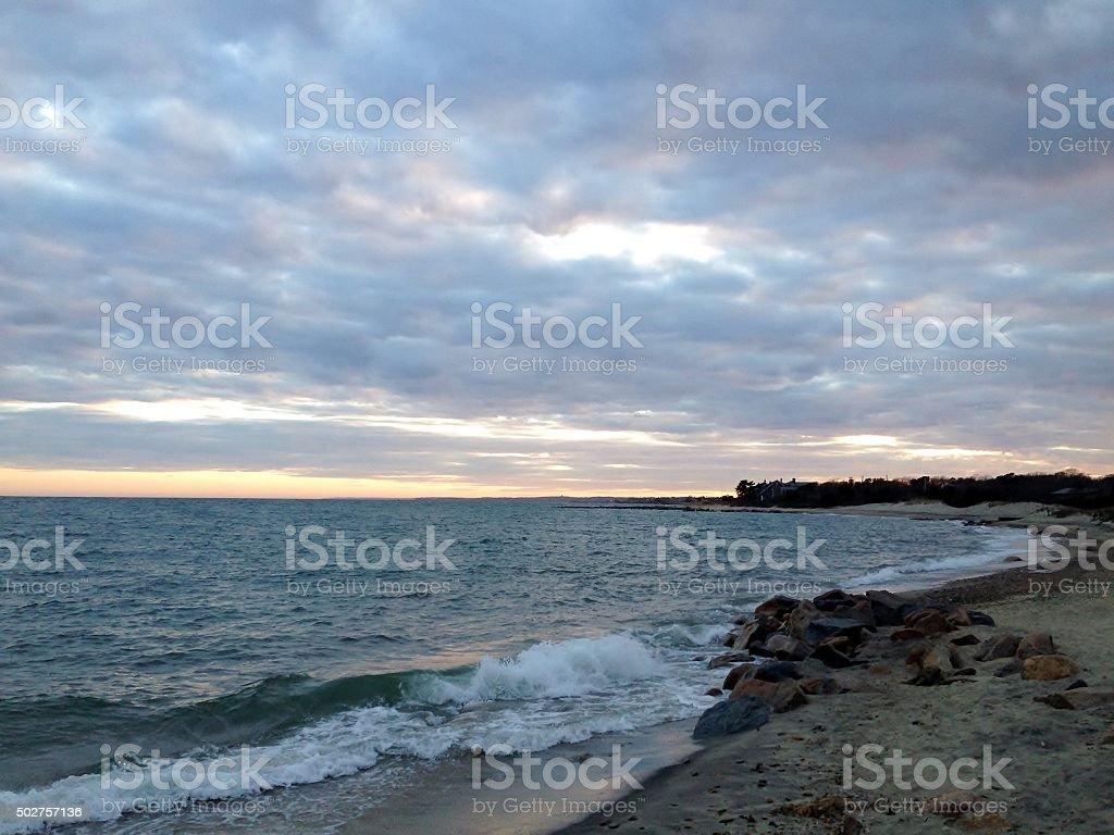 Ocean shoreline at sunset stock photo