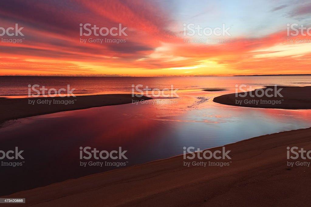 Ocean Sunrise on Sandy Beach stock photo