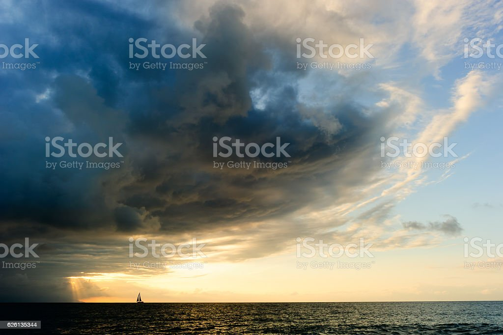 Ocean Sunset Sailboat Storm stock photo