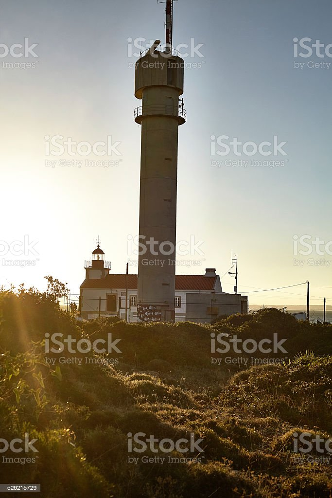 Ocean sunset with lighthouse stock photo