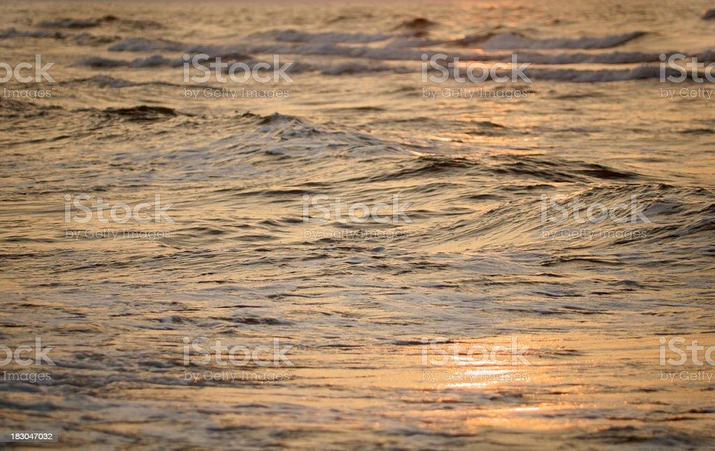Ocean surface reflecting sunset. stock photo