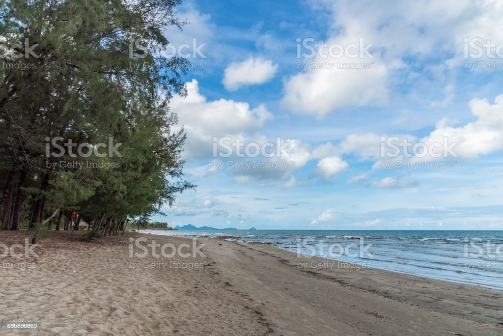 Ocean tropical beach with waves, sand and blue sky in summer. stock photo