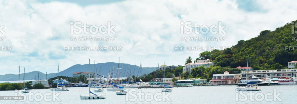 Ocean view of sail boats in the mist of Tortola British Virgin Islands on a cal summer day stock photo