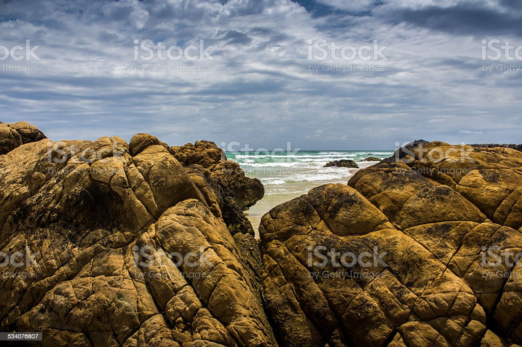 Ocean view with rocks in the foreground. stock photo