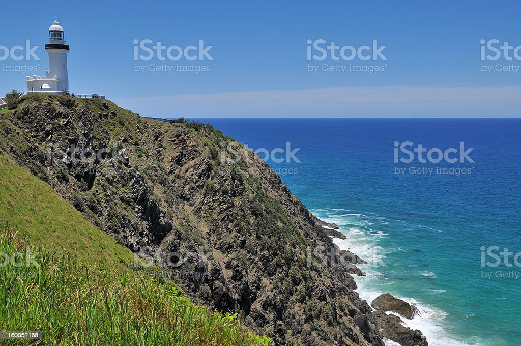 Ocean view with the Cape Byron lighthouse (Australia) stock photo
