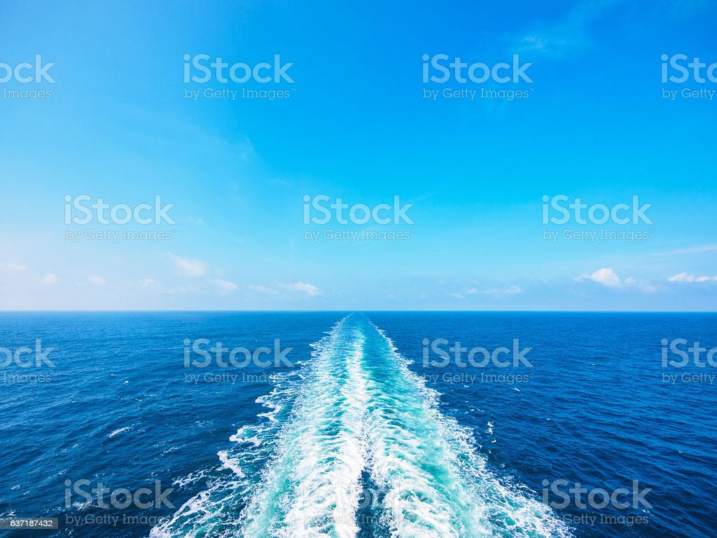 Ocean wake from cruise ship, on bright summer day. stock photo