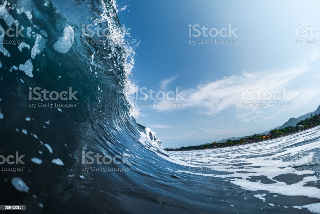Ocean wave breaks on the shore stock photo