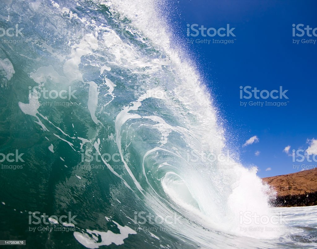 Ocean wave forming a tube for a surfer stock photo