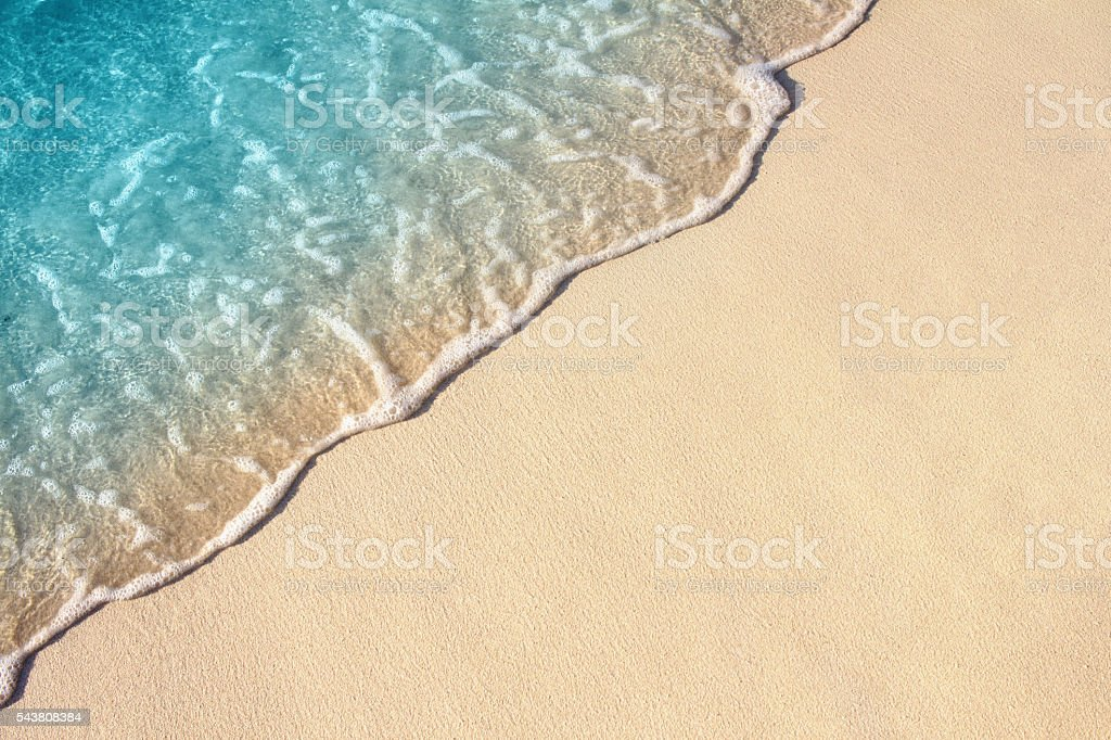 Ocean wave on sandy beach, background stock photo