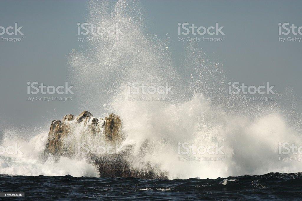 Ocean Wave Surf Spray Crashes Rock stock photo