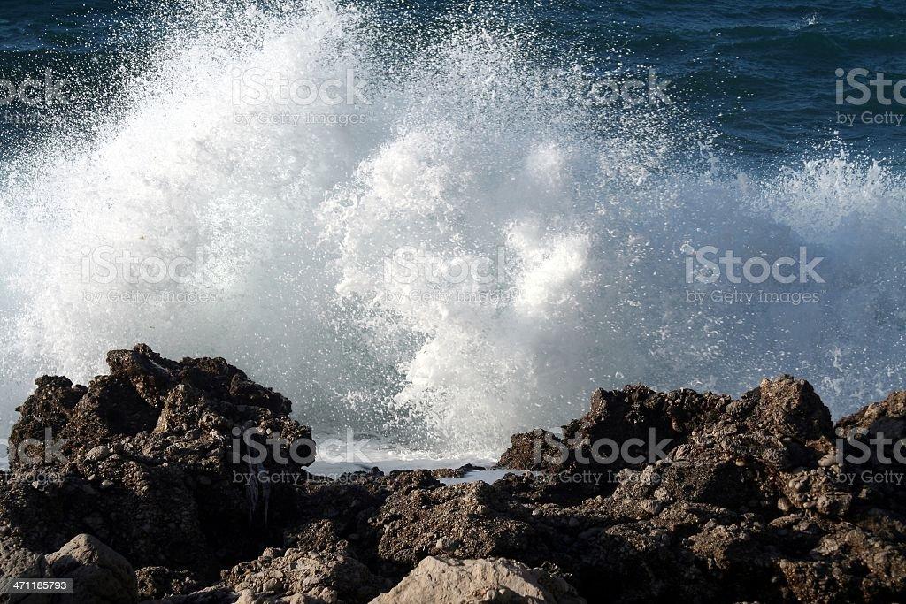 Ocean waves crashing against the rocks stock photo