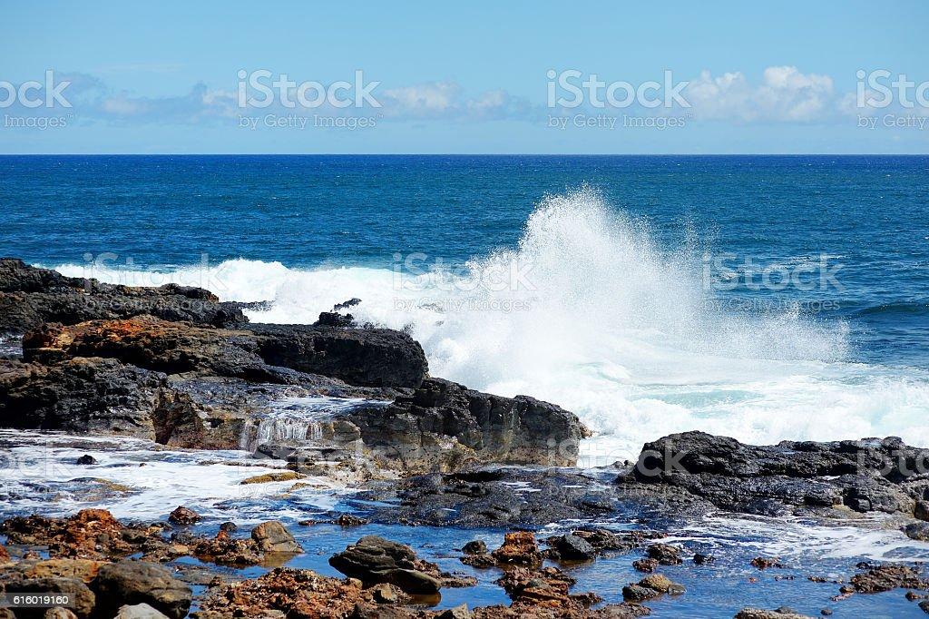 Ocean waves crashing on rocks stock photo