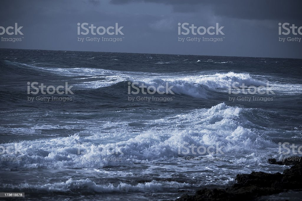 Ocean waves pound the surf stock photo