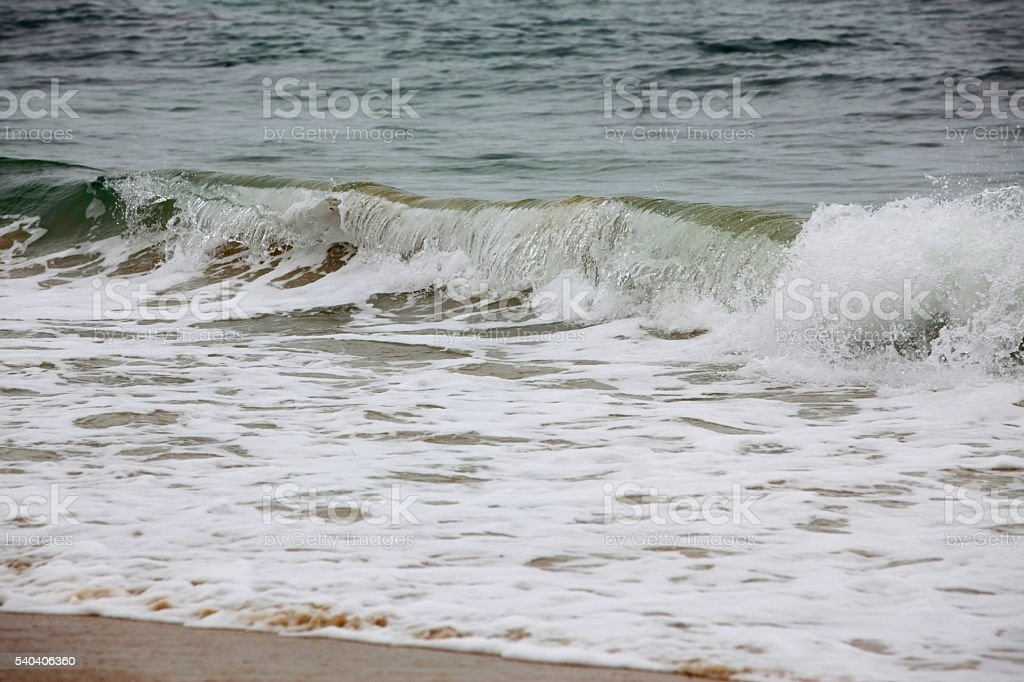 Ocean waves rushing to the sandy coast. stock photo