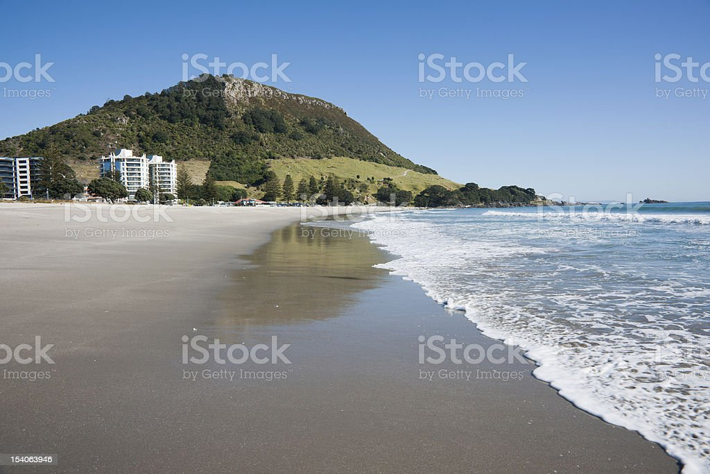 Ocean waves wash Mount Maunganui beach stock photo