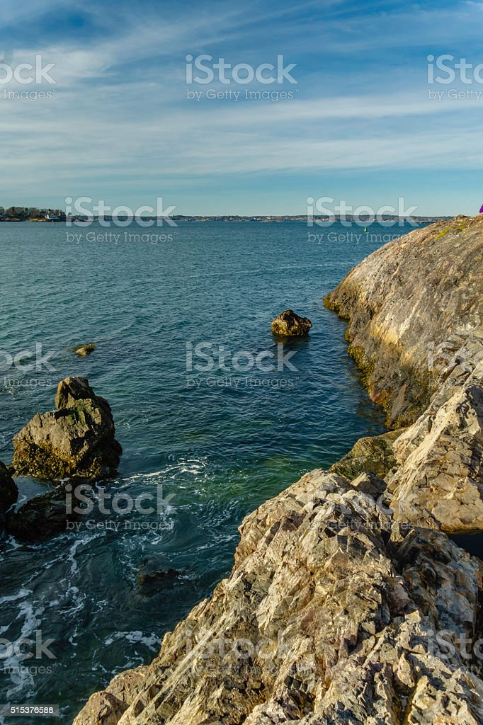 ocean with rocks and blue sky stock photo