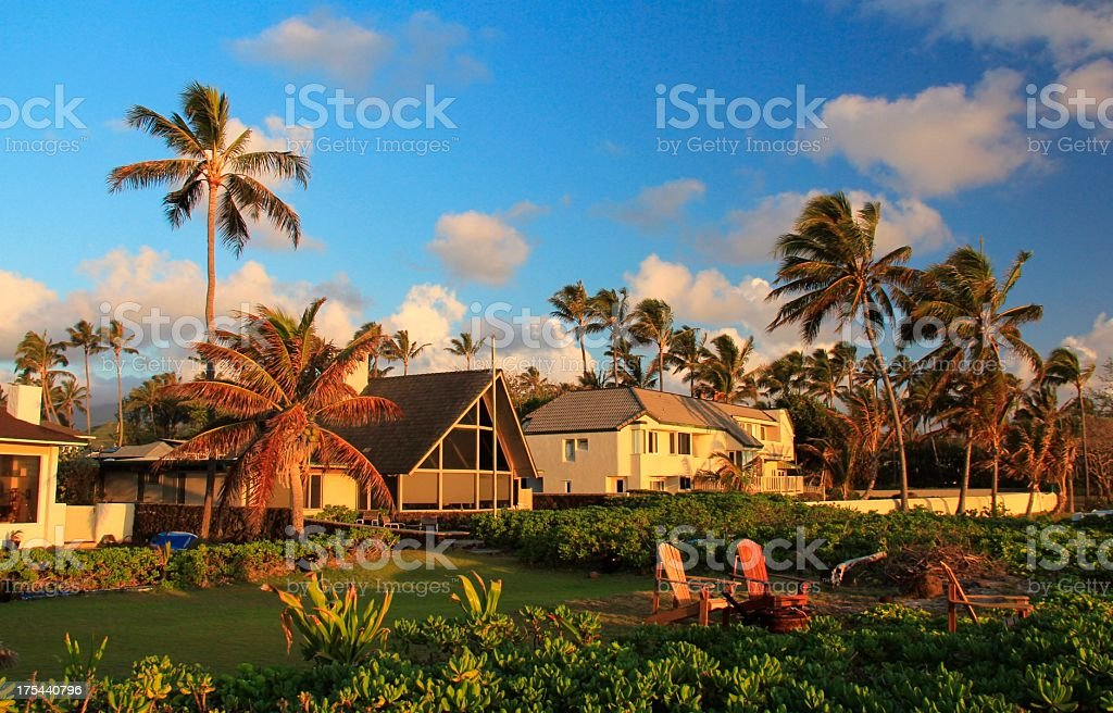 Oceanfront home on Oahu Hawaii at sunset stock photo