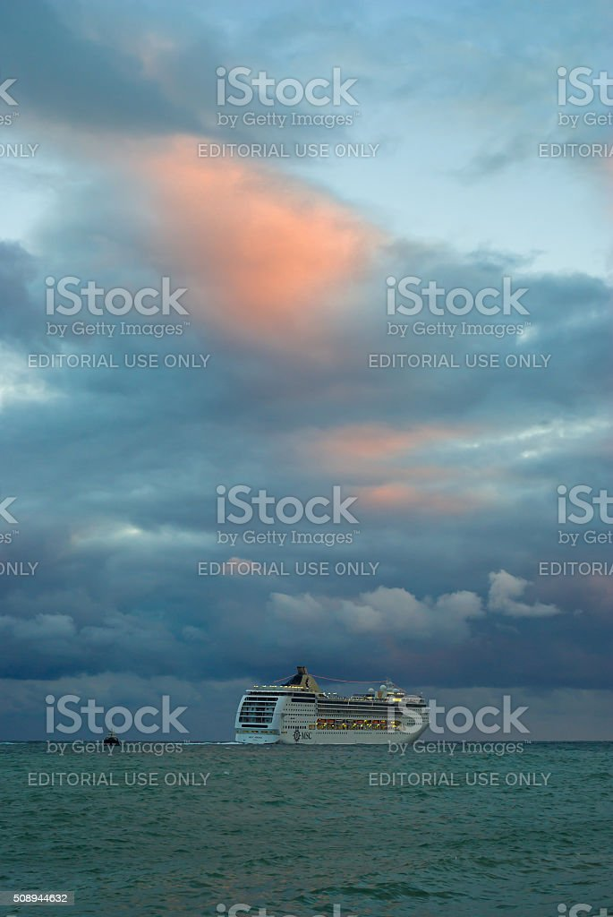 Oceanic ship sailing off from Yalta port at fall evening stock photo