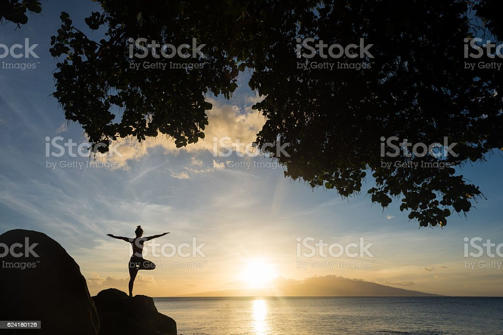 Oceanside meditation at sunset stock photo